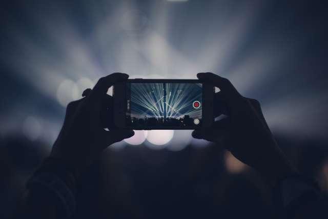 Smartphone filming a concert.